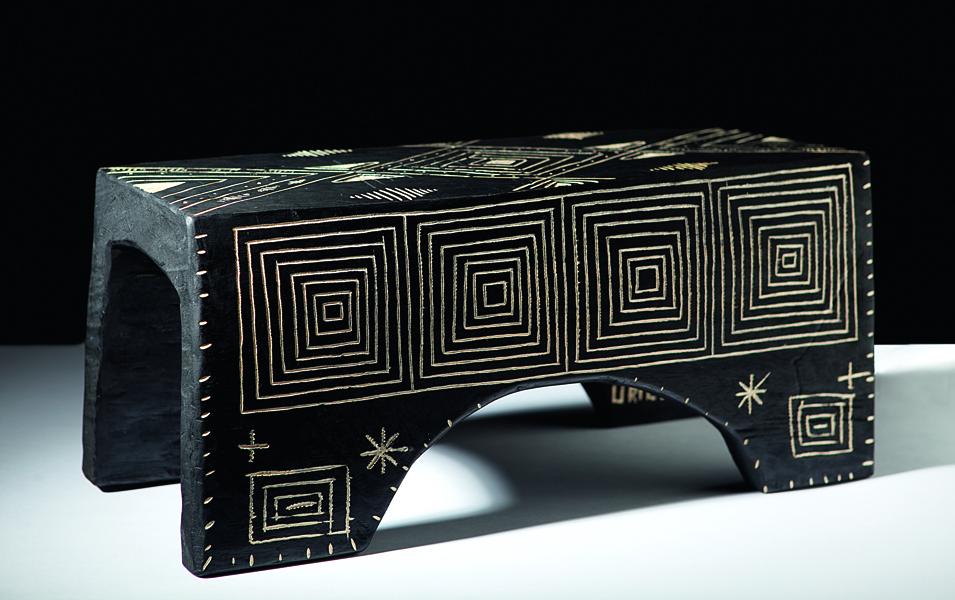 Butacos tallados en madera, artesano Carlos Gaitán, Cooperativa Coopalomeko, Meta.