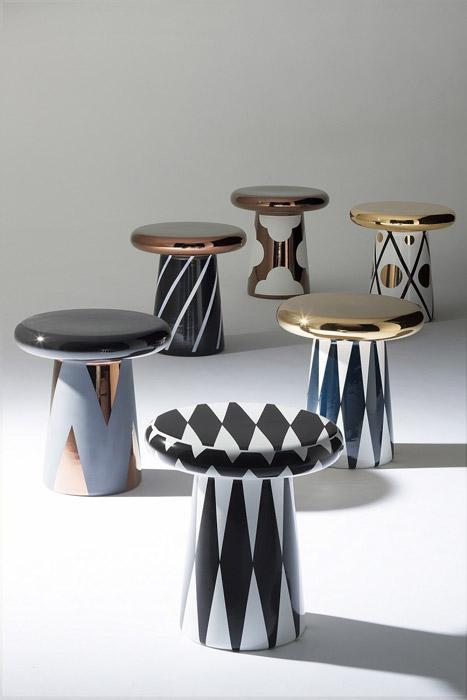 La T Table en forma de hongo viene en dorados, cobre y blanco y la colección Joya tiene bordes en forma de diamantes y en ángulo curvo en la parte superior.