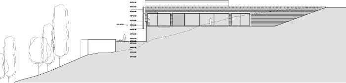 Una escalera de un tramo conduce al nivel de las habitaciones bajo la alcoba principal.