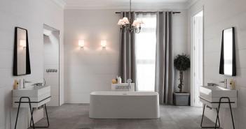 Como  la piedra  El avance en las técnicas de la cerámica se aprecia en la calidad de color y textura de los revestimientos de muros y pisos de Porcelanosa. El revestimiento Barbados Blanco, de 31,6 x 90 cm, evoca un acabado clásico en el muro, mientras que el piso México Stone, en piezas de 43,5 x 65,9 cm, da una lectura cálida. Muebles, accesorios y griferías de la línea Pure Line y la bañera Lounge Square blanca configuran un ambiente clásico y discreto.